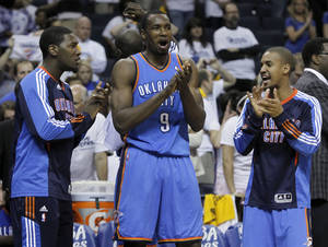 Photo - CELEBRATION: Oklahoma City Thunder players Royal Ivey, left, Serge Ibaka (9) and Eric Maynor, right, celebrate in the final moments of the third overtime period against the Memphis Grizzlies in Game 4 of a second-round NBA basketball playoff series on Tuesday, May 10, 2011, in Memphis, Tenn. Oklahoma City won 133-123 in triple overtime. (AP Photo/Lance Murphey) ORG XMIT: TNMH149
