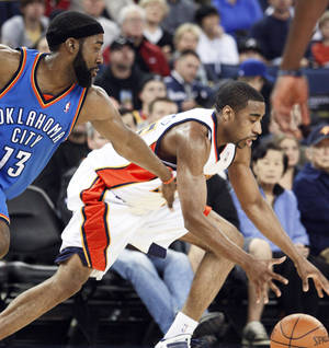 Photo - Golden State's Reggie Williams, right, steals the ball from Thunder guard James Harden during Sunday's game. AP PHOTO