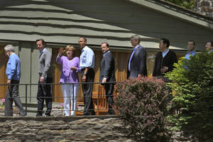 photo -   World leaders walk to the family photo session at the G-8 Summit at Camp David, Md., Saturday, May 19, 2012. From left are Italian Premier Mario Monti, British Prime Minister David Cameron, German Chancellor Angela Merkel, U.S. President Barack Obama, French President Francois Hollande, Canadian Prime Minister Stephen Harper, Japanese Prime Minister Yoshihiko Noda, Russian Prime Minister Dmitri Medvedev and European Commission President Jose Manuel Barroso. (AP Photo/Philippe Wojazer, Pool)