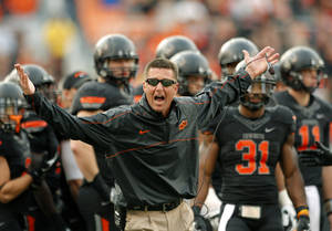 photo - Oklahoma State head coach Mike Gundy argues a call during a college football game between Oklahoma State University (OSU) and Texas Christian University (TCU) at Boone Pickens Stadium in Stillwater, Okla., Saturday, Oct. 27, 2012. Photo by Sarah Phipps, The Oklahoman