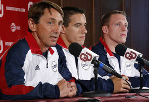 Photo - OU gymnastics coach Mark Williams, left, has guided a program that has produced Olympians like Jake Dalton, center, and Steven Legendre, right. Photo by Steve Sisney, The Oklahoman