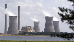 photo - FILE - In this July 10, 2007, file photo, the coal-fired Plant Scherer in operation at Juliette, Ga. For the second year in a row, the EPA's data shows that the largest greenhouse gas polluter in the nation in 2011 was the Scherer power plant in Juliette. The plant, owned by Atlanta-based Southern Co., reported releasing more than 22 million metric tons of carbon dioxide, the chief greenhouse gas, in 2011. Heat-trapping gases from U.S. power plants fell 4.6 percent in 2011 from the previous year as plants burned less coal, the biggest source of greenhouse gas pollution, according to a new government report. (AP Photo/Gene Blythe, File)