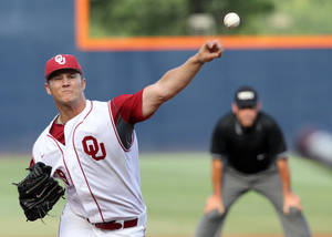 photo - Oklahoma pitcher John Jordan (19) throws the ball during an NCAA college baseball tournament regional game against Appalachian State in Charlottesville, Va., Saturday, June 2, 2012. (AP Photo/Andrew Shurtleff) ORG XMIT: VAAS102