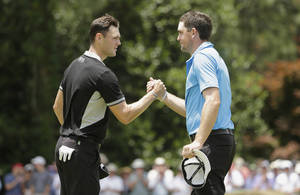Photo - Martin Kaymer, of Germany, left, shakes hands with Keegan Bradley after the second round of the U.S. Open golf tournament in Pinehurst, N.C., Friday, June 13, 2014. (AP Photo/Chuck Burton)