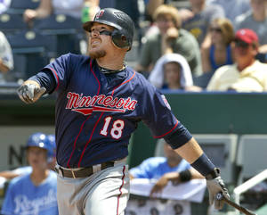 photo -   Minnesota Twins' Ryan Doumit (18) hits a solo home run during the sixth inning of a baseball game against the Kansas City Royals at Kauffman Stadium in Kansas City, Mo., Sunday, July 22, 2012. (AP Photo/Orlin Wagner)