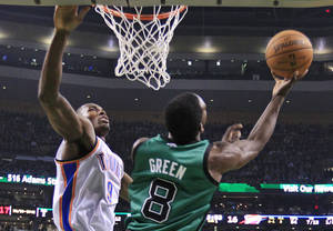 Photo - Boston Celtics forward Jeff Green (8) goes up for a reverse layup against Oklahoma City Thunder forward Serge Ibaka (9) during the first half of an NBA basketball game in Boston, Friday, Nov. 23, 2012. (AP Photo/Elise Amendola) ORG XMIT: MAEA103