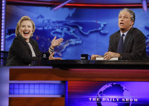 "Photo - Former U.S. Secretary of State Hillary Rodham Clinton reacts to host Jon Stewart during a taping of ""The Daily Show with Jon Stewart,"" Tuesday, July 15, 2014, in New York.  (AP Photo/Frank Franklin II) ** Usable by LA, DC, CGC and CCT Only **"
