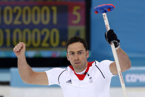 Photo - Britain's skip David Murdoch celebrates his winning throw during a tiebreaker game against Norway in men's curling competition against at the 2014 Winter Olympics, Tuesday, Feb. 18, 2014, in Sochi, Russia. (AP Photo/Robert F. Bukaty)
