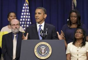 photo - President Barack Obama talks abut taxes, Friday, August 3, 2012, in Eisenhower Executive Office Building on the White House campus in Washington. (AP Photo/J. Scott Applewhite) 