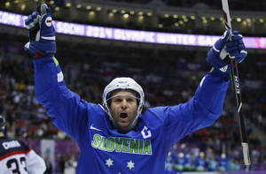 Photo - Slovenia forward Tomaz Razingar reacts after scoring a goal against Slovakia in the third period of a men's ice hockey game at the 2014 Winter Olympics, Saturday, Feb. 15, 2014, in Sochi, Russia. (AP Photo/Julio Cortez)