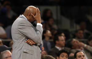 Photo - New York Knicks head coach Mike Woodson reacts in the second half of Game 1 of their NBA basketball playoff series in the Eastern Conference semifinals against the Indiana Pacers at Madison Square Garden in New York, Sunday, May 5, 2013. The Pacers won 102-95. (AP Photo/Kathy Willens)