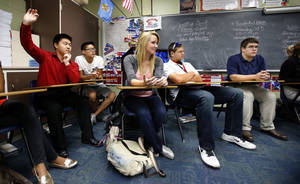 photo - Moore High School students listen Thursday during a discussion of the presidential election in Liz Butcher's government class.  Photo by Steve Sisney, The Oklahoman