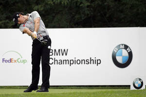 photo -   Rory McIlroy, of Northern Ireland, hits a tee shot on the 16th hole during the BMW Championship PGA golf tournament at Crooked Stick Golf Club in Carmel, Ind., Sunday, Sept. 9, 2012. McIlroy won the event. (AP Photo/Charles Rex Arbogast)