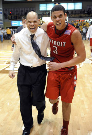 Photo - Detroit coach Ray McCallum, left, celebrates with his son and guard Ray McCallum Jr. following the team's 70-50 victory over Valparaiso University in an NCAA college basketball game for the Horizon League men's tournament title Tuesday, March 6, 2012, in Valparaiso, Ind. (AP Photo/Joe Raymond) ORG XMIT: INJR112