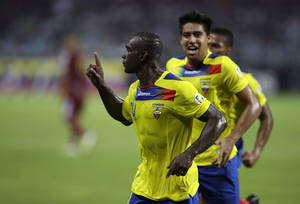 Photo -   Followed by teammates, Ecuador's Segundo Castillo, left, celebrates after scoring against Venezuela during a World Cup 2014 qualifying soccer match in Puerto La Cruz, Venezuela, Tuesday, Oct. 16, 2012. (AP Photo/Fernando Llano)