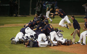 Photo - Pepperdine players celebrates on the mound after the final out against Cal Poly in an NCAA college baseball tournament regional game on Sunday, June 1, 2014, in San Luis Obispo, Calif. (AP Photo/Aaron Lambert)