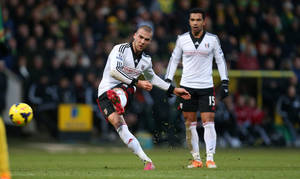 Photo - Fulham's Pajtim Kasami scores with a free kick to equalize for his team, during their English Premier League soccer match against Norwich City at Carrow Road, Norwich, England, Thursday, Dec. 26, 2013. (AP Photo/Stephen Pond, PA Wire)   UNITED KINGDOM OUT  -  NO SALES   -  NO ARCHIVES