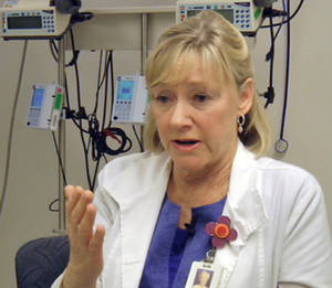 Photo - In this frame grab from Saturday, April 20, 2013, video, Massachusetts General Hospital nurse Jean Acquadra talks about the horrific early hours as bloody patients poured in after the explosions at the Boston Marathon. (AP Photo/Carla K. Johnson)