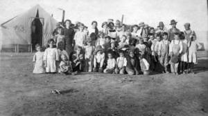 Photo - This 1914 photo provided by the Denver Public Library, Western History Collection, shows children and some adults posing for a photo at camp Ludlow in south central Colorado.  Two women and 11 children died in a fire at the camp during a battle between the Colorado National Guard and striking coal miners. Sunday April 20, 2014 is the 100th anniversary of the Ludlow Massacre. (AP Photo/Denver Public Library, Western History Collection)