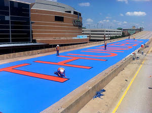 "Photo - Sherwood Construction, the demolition company working on the old I-40, wanted to show their support for the Thunder.  They painted ""Thunder Up"" in 23' tall letters on the bridge deck just south of the arena."