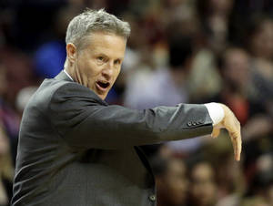 Photo - Philadelphia 76ers coach Brett Brown talks to his team during the first half of an NBA basketball game against the Chicago Bulls in Chicago on Saturday, March 22, 2014. (AP Photo/Nam Y. Huh)