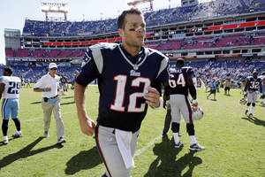 Photo -   New England Patriots quarterback Tom Brady (12) leaves the field after defeating the Tennessee Titans 34-13 in an NFL football game, Sunday, Sept. 9, 2012, in Nashville, Tenn. (AP Photo/Wade Payne)