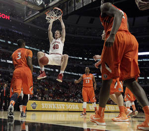 Photo - Indiana's Cody Zeller (40) dunks during the second half of an NCAA college basketball game at the Big Ten tournament against Illinois Friday, March 15, 2013, in Chicago. Indiana won 80-64. (AP Photo/Nam Y. Huh)  ORG XMIT: ILMG119
