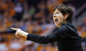 Photo - FILE - In this Jan. 20, 2014 file photo, Notre Dame head coach Muffet McGraw yells to her team in the second half of an NCAA college basketball game against Tennessee, in Knoxville, Tenn. Notre Dame and Connecticut are on an unprecedented collision course to meet in the national championship game. First, the two unbeaten teams will have to win their national semifinal games before the historic matchup can take place. (AP Photo/Wade Payne, File)