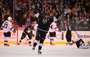 Photo - Los Angeles Kings center Anze Kopitar, of Slovenia, celebrates his game-winning goal during overtime of their NHL hockey game against the San Jose Sharks, Wednesday, Oct. 30, 2013, in Los Angeles. (AP Photo/Mark J. Terrill)