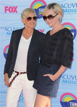 Photo - Ellen DeGeneres, left, and Portia de Rossi arrive at the Teen Choice Awards on Sunday, July 22, 2012, in Universal City, Calif. (Photo by Jordan Strauss/Invision/AP)