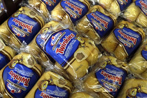 photo -   FILE - In this Friday, Nov. 16, 2012, file photo, Twinkies baked goods are displayed for sale at the Hostess Brands' bakery in Denver, Colo. Hostess Brands Inc. and its second largest union will go into mediation to try and resolve their differences, meaning the company won't go out of business just yet. The news came Monday, Nov. 19, 2012, after Hostess moved to liquidate and sell off its assets in bankruptcy court citing a crippling strike last week. (AP Photo/Brennan Linsley)