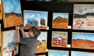 Photo -  Laurie Dale Keffer tags paintings done by her husband, Oklahoma City artist Jim Keffer, in preparation for the 2012 Festival of the Arts. Photo by Doug Hoke, The Oklahoman <strong>DOUG HOKE</strong>