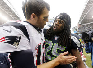 photo -   Seattle Seahawks' Richard Sherman (25) talks with New England Patriots quarterback Tom Brady after an NFL football game, Sunday, Oct. 14, 2012, in Seattle. The Seahawks won 24-23. (AP Photo/Elaine Thompson)