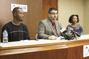 Photo - Adam Soltani, center, Oklahoma executive director for a Muslim civil-rights group, Saadiq Long, a Muslim man who recently returned to Oklahoma from the Middle East, and Long's sister, Ava Anderson, appear at a news conference Thursday.  Photo by Paul Hellstern, The Oklahoman