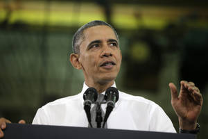 photo - President Barack Obama speaks as he Linamar Corporation in Arden, N.C., Wednesday, Feb. 13, 2013, the day after delivering his State of the Union address. (AP Photo/Charles Dharapak)