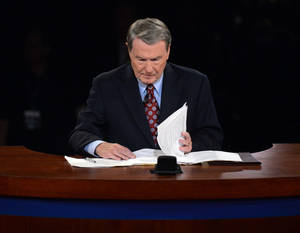 Photo -   Moderator Jim Lehrer looks over his notes before the first presidential debate at the University of Denver, Wednesday, Oct. 3, 2012, in Denver. (AP Photo/Pool-Michael Reynolds)