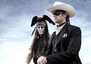 "Photo - This publicity image released by Disney shows Johnny Depp as Tonto, left, and Armie Hammer as The Lone Ranger, in a scene from ""The Lone Ranger,"" opening July 3, 2013. (AP Photo/Disney Enterprises, Inc. and Jerry Bruckheimer Inc., Peter Mountain)"