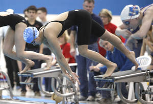 Photo - Classen's Chelsea Ye pushes away from the starting block in the girl's 100 yard freestyle during the 5A State Swimming finals at Oklahoma City Community College in Oklahoma City, OK, Saturday, Feb. 18, 2012. By Paul Hellstern, The Oklahoman