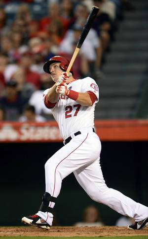 Photo - In this photo provided by Angels Baseball LP, Los Angeles Angels' Mike Trout follows through on a home run against the Boston Red Sox the third inning of a baseball game, Saturday, July 6, 2013, in Anaheim, Calif.  (AP Photo/Angels Baseball LP, Matt Brown)