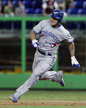 Photo -   Toronto Blue Jays' Brett Lawrie prepares to round second base after hitting a triple against the Miami Marlins during the first inning of an interleague baseball game Friday, June 22, 2012, in Miami. (AP Photo/Alan Diaz)
