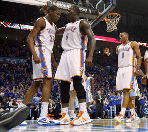 Photo - Oklahoma City's Kevin Durant (35), Kendrick Perkins (5), and Russell Westbrook (0) react during the NBA basketball game between the Denver Nuggets and the Oklahoma City Thunder in the first round of the NBA playoffs at the Oklahoma City Arena, Sunday, April 17, 2011. Photo by Bryan Terry, The Oklahoman