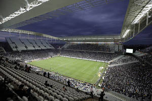 Photo - Corinthians's and Botafogo players battle it out during a Brazilian soccer league match at the Itaquerao, the stadium that will host the World Cup opener match between Brazil and Croatia on June 12, in Sao Paulo, Brazil, Sunday, June 1, 2014. (AP Photo/Andre Penner)