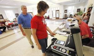 photo - Jeff and Carol Thibodeau vote at Holy Trinity Lutheran Church in Edmond, Tuesday, June 26, 2012. Photo By David McDaniel/