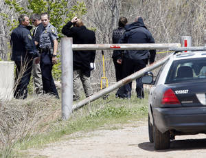 Photo - Oklahoma City police investigate a body found Saturday in the Stinchcomb  Wildlife Refuge just north of the end of Morgan Road near the Kilpatrick Turnpike in Oklahoma City. Photo by Nate Billings, The Oklahoman