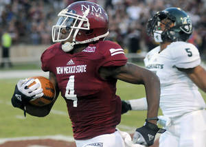 Photo -   New Mexico State's Austin Franklin (4) runs the ball into the end zone against Sacramento State during an NCAA college football game in Las Cruces, N.M., Thursday, Aug. 30, 2012. (AP Photo/The Las Cruces Sun-News, Robin Zielinski)