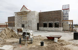 Photo - Construction proceeds on a Chicken Express on the south side of Danforth Road west of Kelly Avenue in Edmond.  Photo by PAUL HELLSTERN, THE OKLAHOMAN