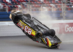 Photo -   Mike Affarano (83) flips his car during the International Motorsports Hall of Fame 250 ARCA auto race at the Talladega Superspeedway in Talladega, Ala., Friday, May 4, 2012. (AP Photo/Dave Martin)
