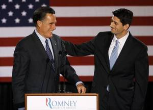 Photo - FILE - House Budget Committee Chairman Rep. Paul Ryan, R-Wis. introduces Republican presidential candidate, former Massachusetts Gov. Mitt Romney before Romney spoke at the Grain Exchange in Milwaukee, in this April 3, 2012 file photo. Romney has picked Wisconsin congressman Paul Ryan to be his running mate, according to a Republican with knowledge of the development. They will appear together Saturday Aug. 11, 2012 in Norfolk, Va., at the start of a four-state bus tour to introduce the newly minted GOP ticket to the nation. (AP Photo/M. Spencer Green, File)