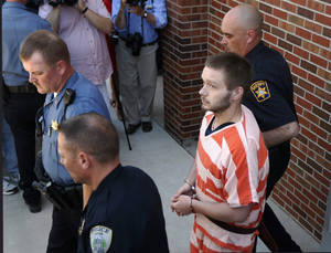 Photo - Kyle Flack is led from the detention center to the Franklin County Courthouse in Ottawa, Kan., Monday, May 13, 2013. Flack is charged with killing four people on an eastern Kansas farm  (AP Photo/Orlin Wagner)
