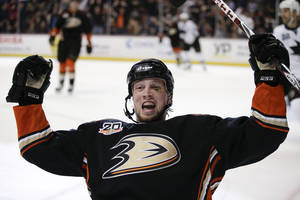 Photo - Anaheim Ducks' Matt Beleskey celebrates his goal during the second period of an NHL hockey game against the San Jose Sharks on Wednesday, April 9, 2014, in Anaheim, Calif. (AP Photo/Jae C. Hong)